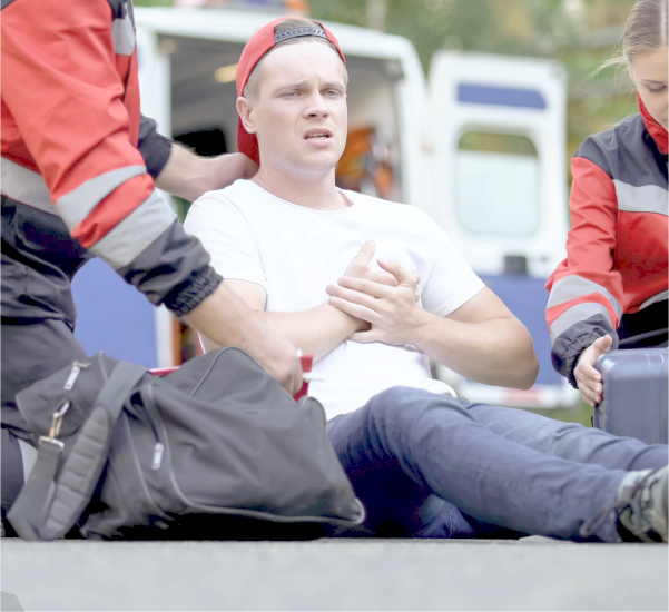 Paramedics caring for man suffering from chest pain, qualified medical care